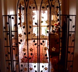 A flowering interior gate adds a delicate touch to this home